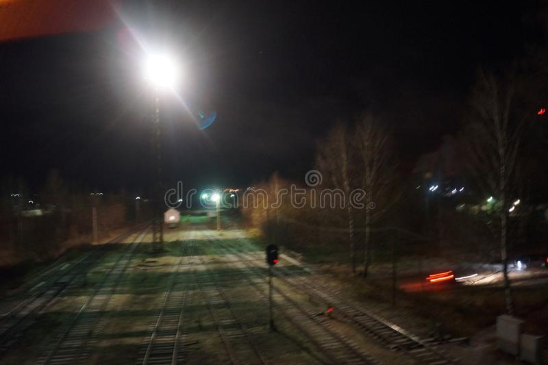 Railway station in the night darkness stock image