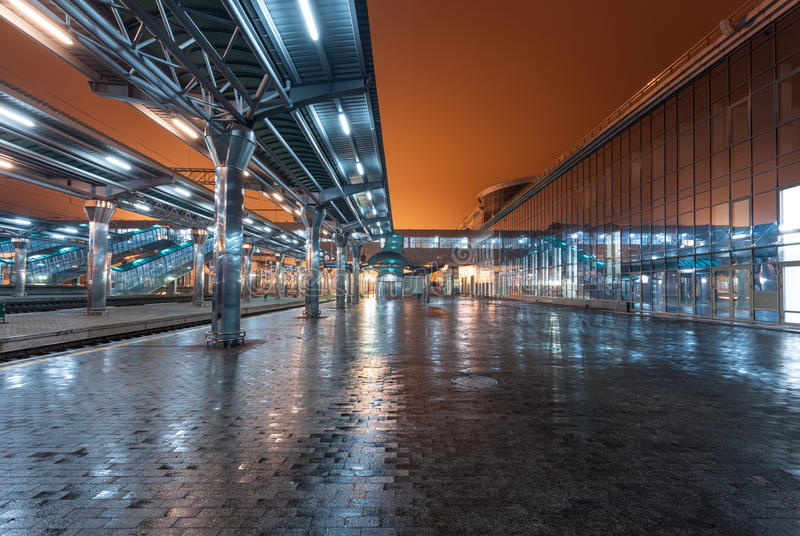 Railway station at night. Train platform in fog. Railroad. In Donetsk stock photography