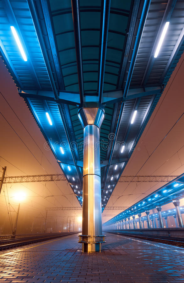 Railway station at night. Train platform in fog. Railroad. In Donetsk stock image