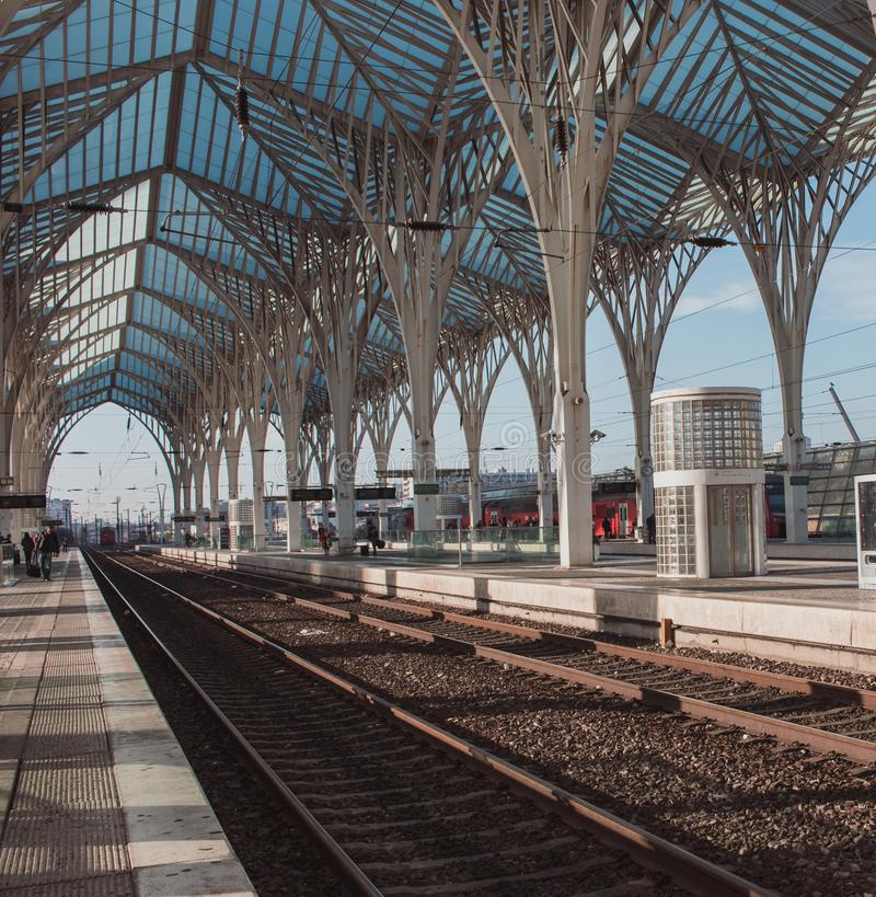 Railway station with outdoor platforms in Lisbon, Portugal. Metal futuristic construction at Lisboa Oriente train station. royalty free stock photos