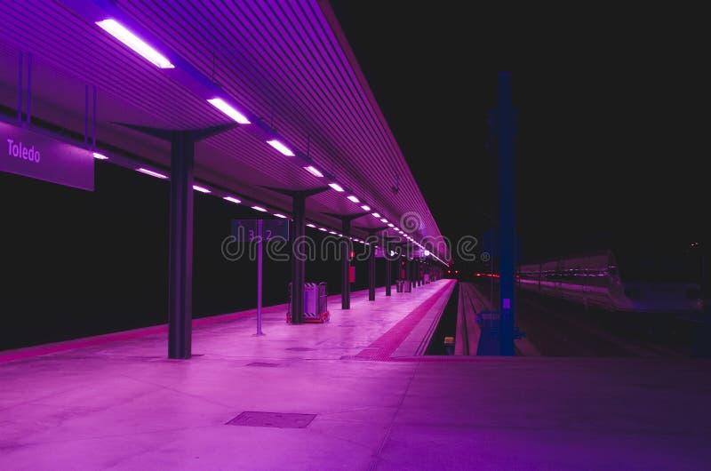 Railway station in purple lighting royalty free stock photos