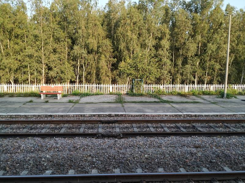 Railway station and long trees in the background stock photography