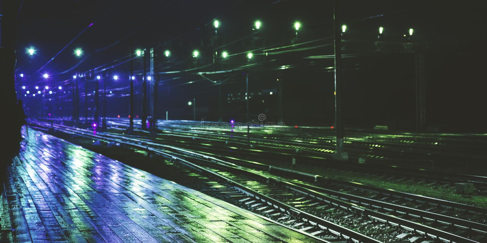 Railway station in rainy night with reflection royalty free stock photography