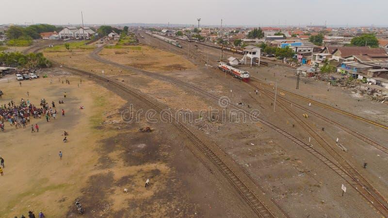 Railway station in Surabaya Indonesia. Railway station in an asian city among buildings. aerial view locomotive and train on railway Surabaya Indonesia stock photography