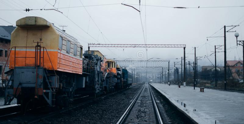 Railway station in winter with trains stock image