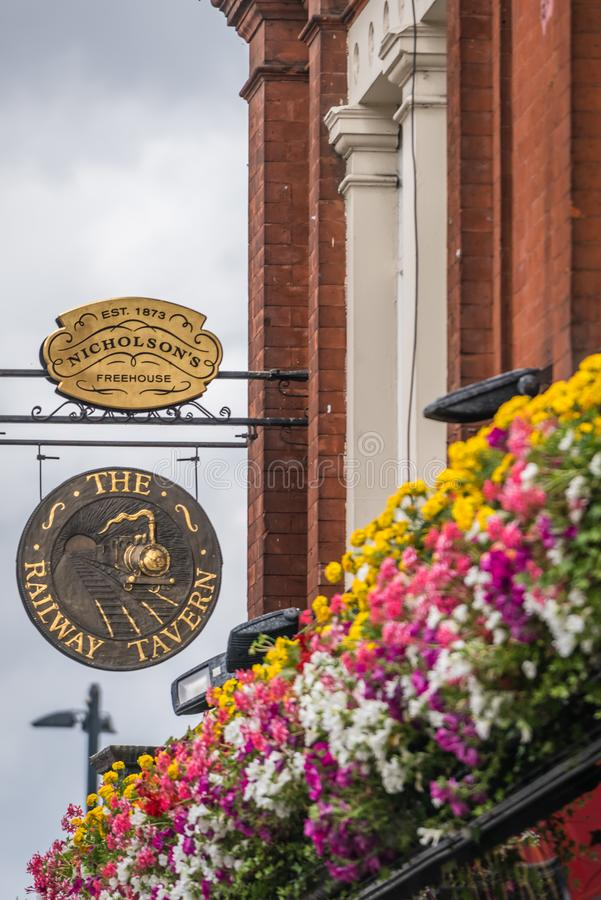London pub sign in Richmond. The Railway tavern pub sign above the popular alcohol serving freehouse in Richmond, London royalty free stock photos