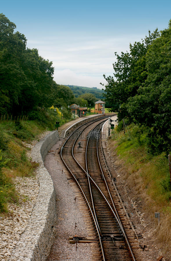 Railway Track. Leading to and from the platform and station at Harmans Cross in Dorset UK. This forms part of the Swanage Steam Railway Network in this area stock images