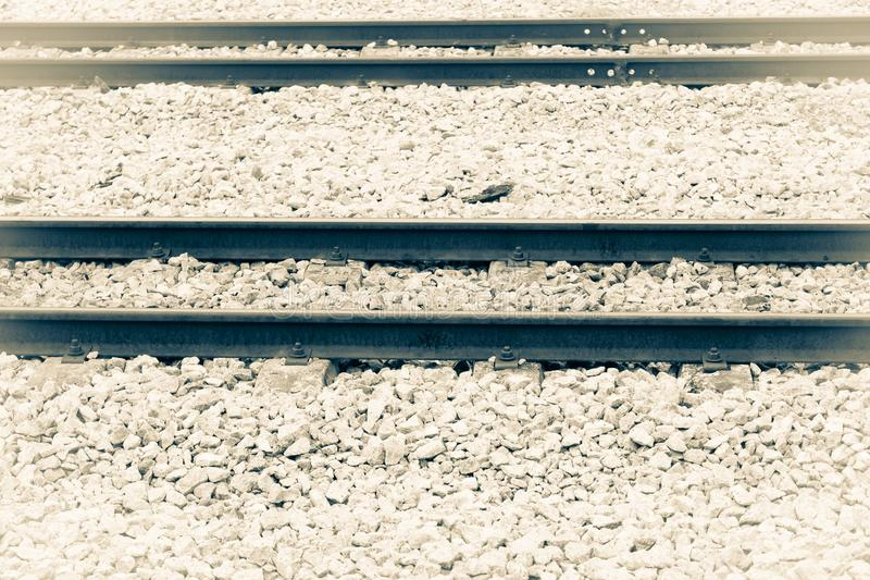 Railway track on gravel for train transportation. monochrome Vintage style. Select focus with shallow depth of field stock images