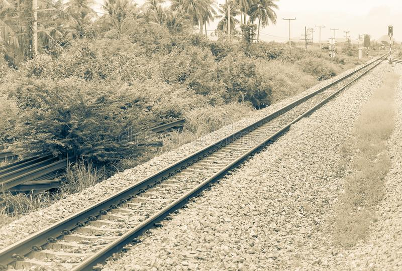 Railway track on gravel for train transportation. monochrome Vintage style. Select focus with shallow depth of field stock image