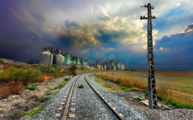 Railway track past engineering plant