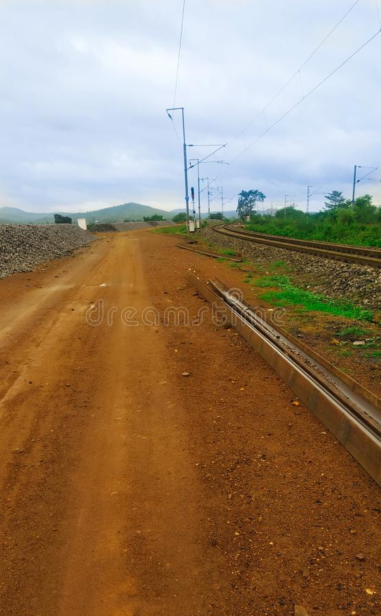 Railway track and it`s side road royalty free stock photography