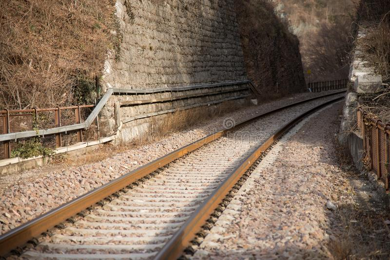 Railway track towards a gallery royalty free stock image