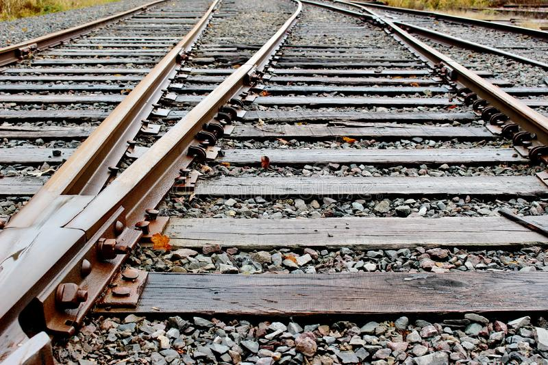 """Railway tracks, Battle Ground, WA, USA. """"The track on a railway or railroad, also known as the permanent way, is the structure consisting of the rails royalty free stock images"""