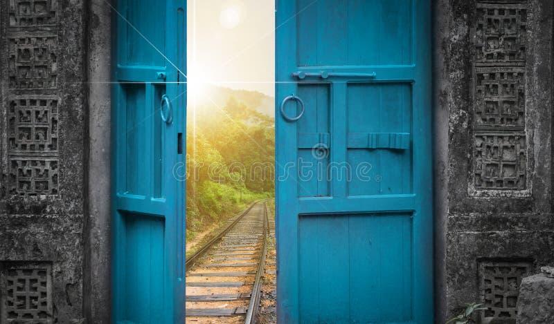 Railway tracks behind open door royalty free stock photo