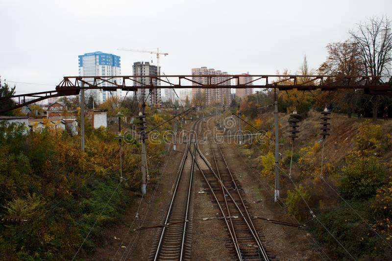 Railway tracks in the city in the fall. Railway tracks within the city limits. Return to the city on a cloudy day stock images