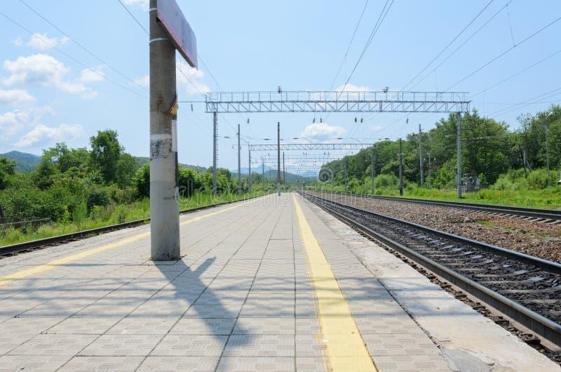 Railway tracks in mountainous terrain extending into perspective stock photos