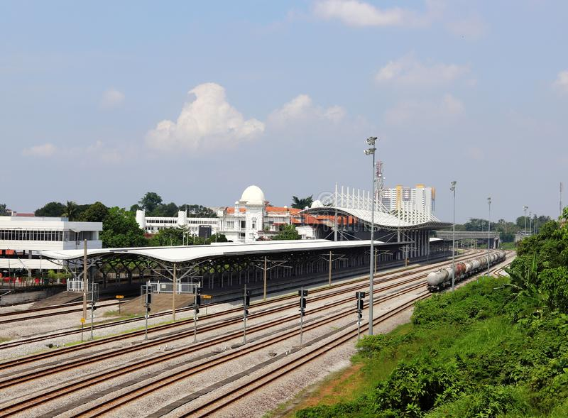 Railway Tracks Running Along the Ipoh Train Station. A view of the platforms and train tracks of the KTM Ipoh railway station during non-peak hours from afar royalty free stock images