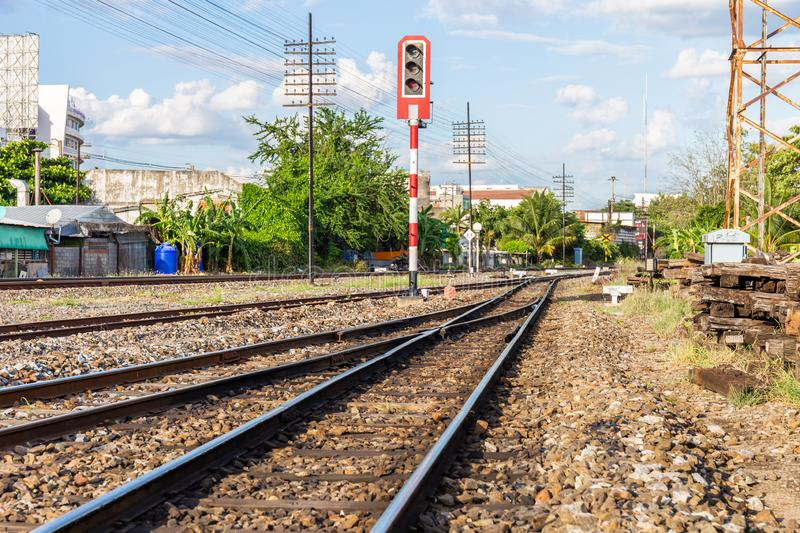 Railway tracks with traffic lights in countryside stock photo