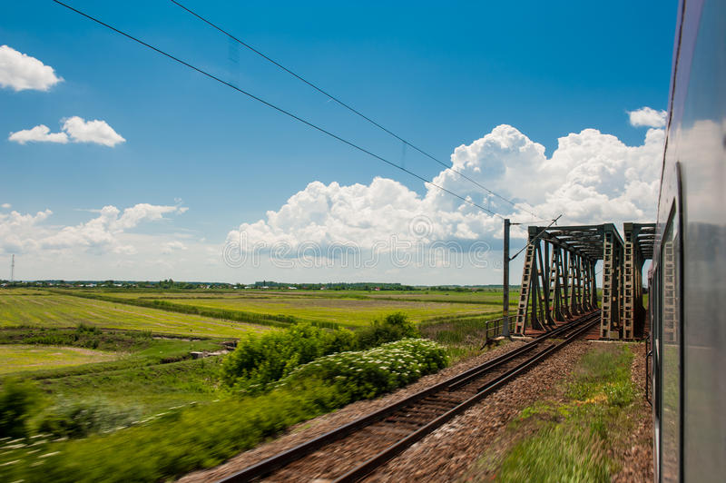 Download Railway And Train Go To Horizon In Green Landscape Under Blue Sky With White Clouds Stock Image - Image: 31640535