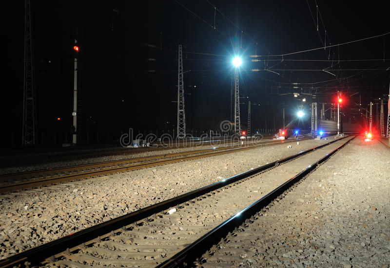 Railway and train signal at night stock photo