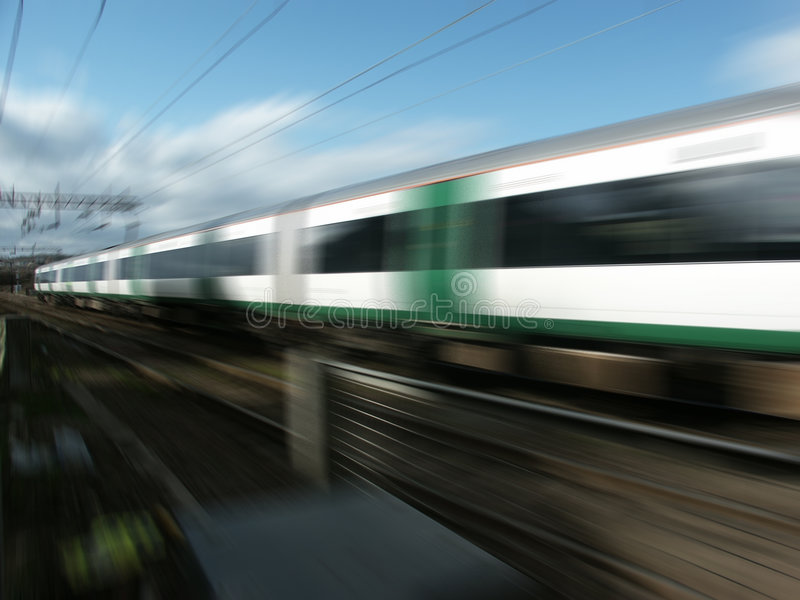 Railway train at speed stock photos