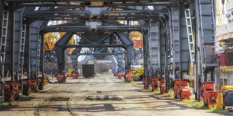 Railway wagon under loading cranes in sea port. royalty free stock images