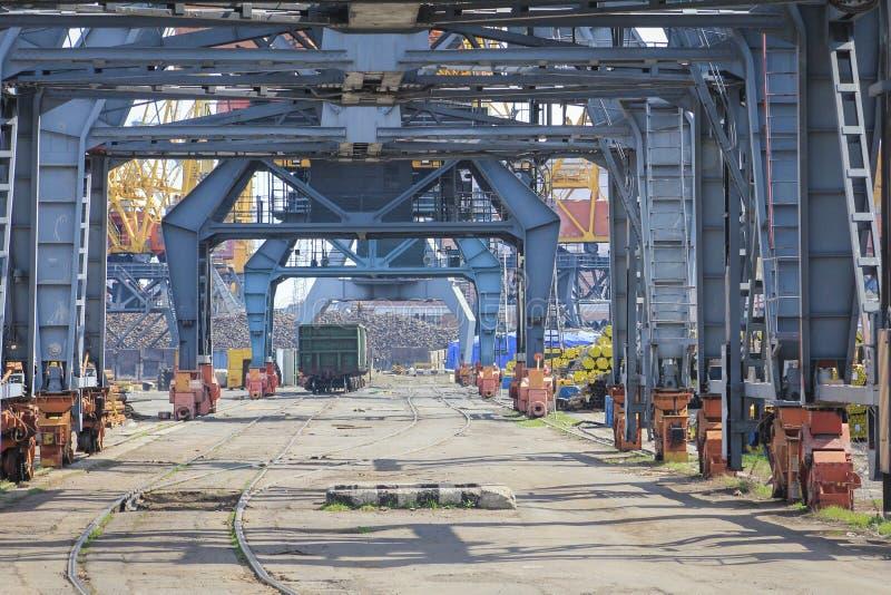 Railway wagon under loading cranes in sea port. stock photo