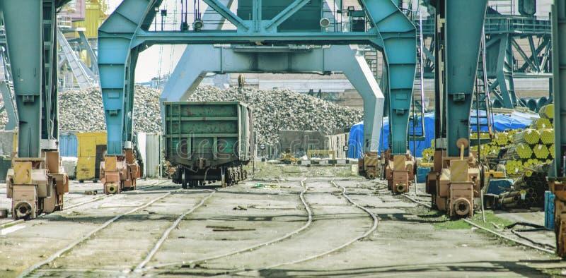 Railway wagon under loading cranes in sea port. stock image