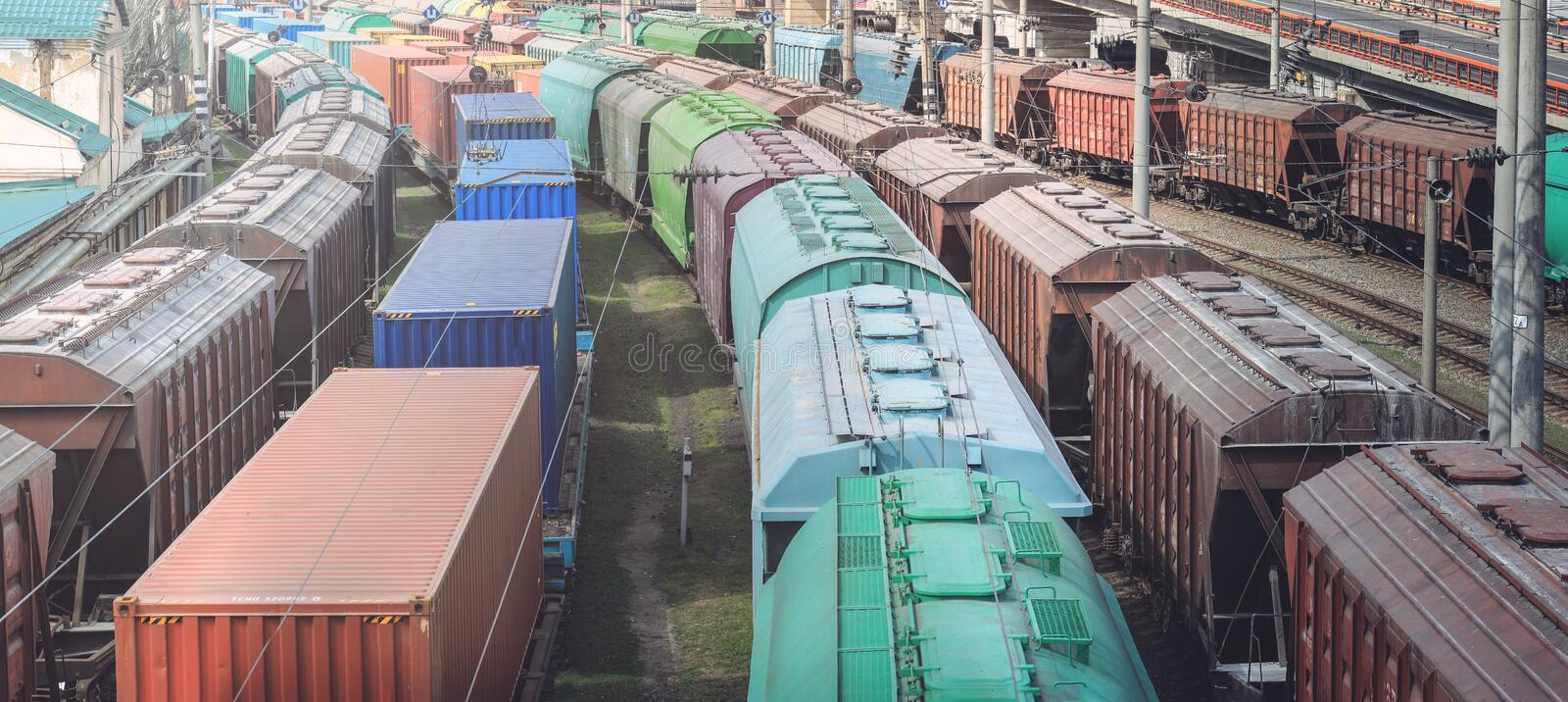 Railway wagons with cargo of metal and grain in port of Odessa. trains are waiting in line for loading at cargo terminal. stock photos