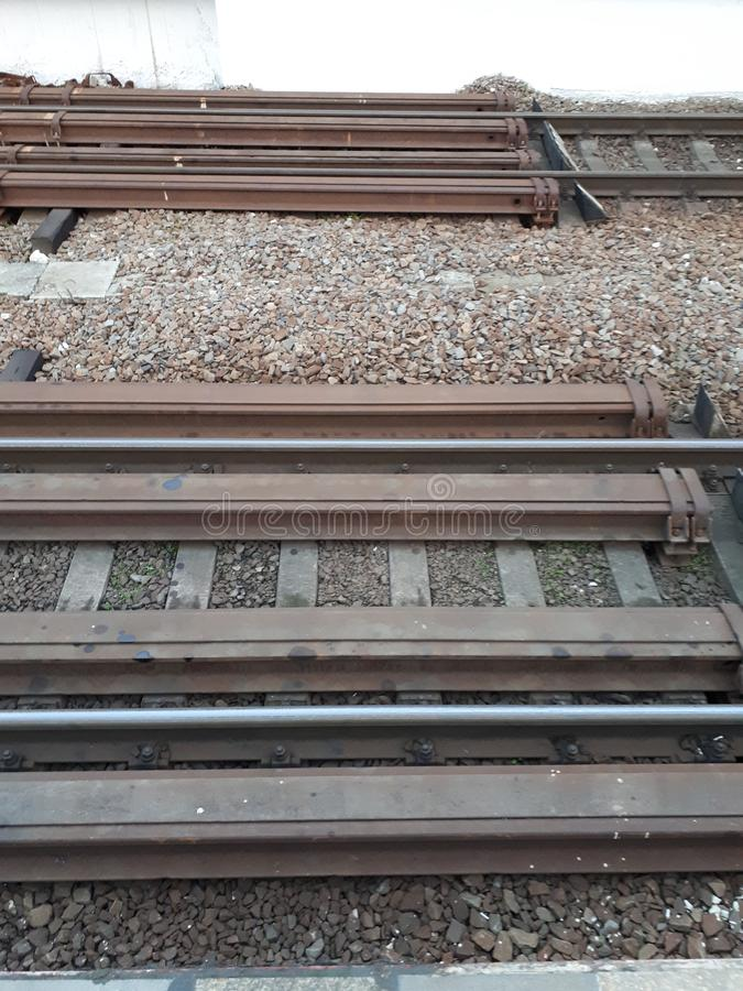 The railway is waiting for the arrival of the train. Rails  are ready to take wagons. stock photos