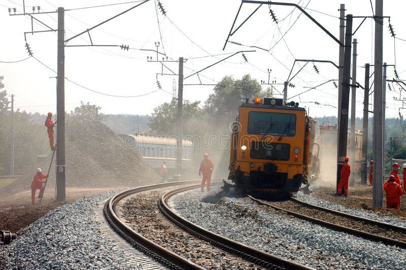 Railway workers. A team of railway workers doing their job stock image