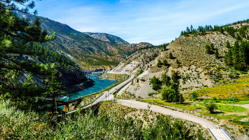 Railways and the Trans Canada Highway follow the Thompson River. With its many rapids flowing through the Canyon in the Coastal Mountain Ranges of British royalty free stock photo