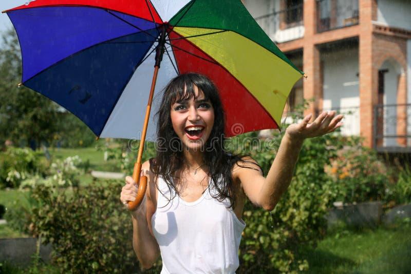 Rain. Lovely woman under umbrella in summer rain stock photography