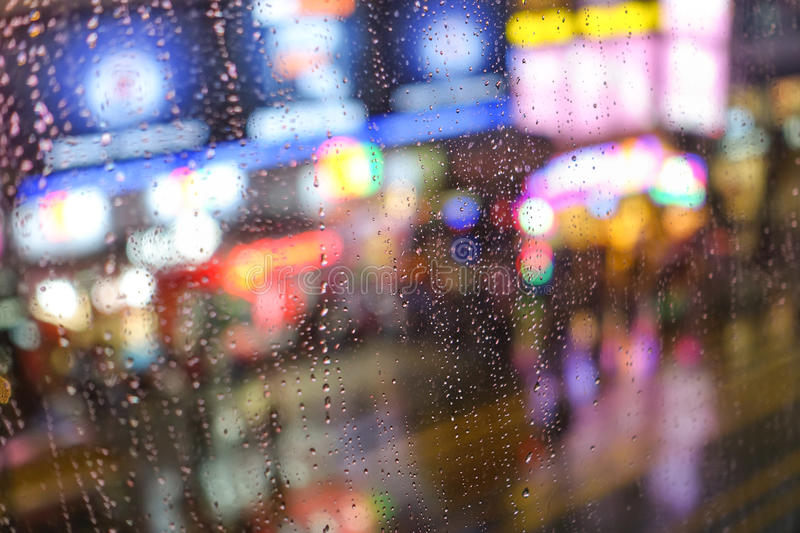 Rain abstract background with defocused lights bokeh stock photo