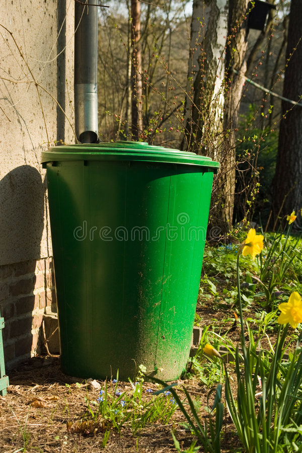 Rain barrel. For saving rain water in a garden stock photos