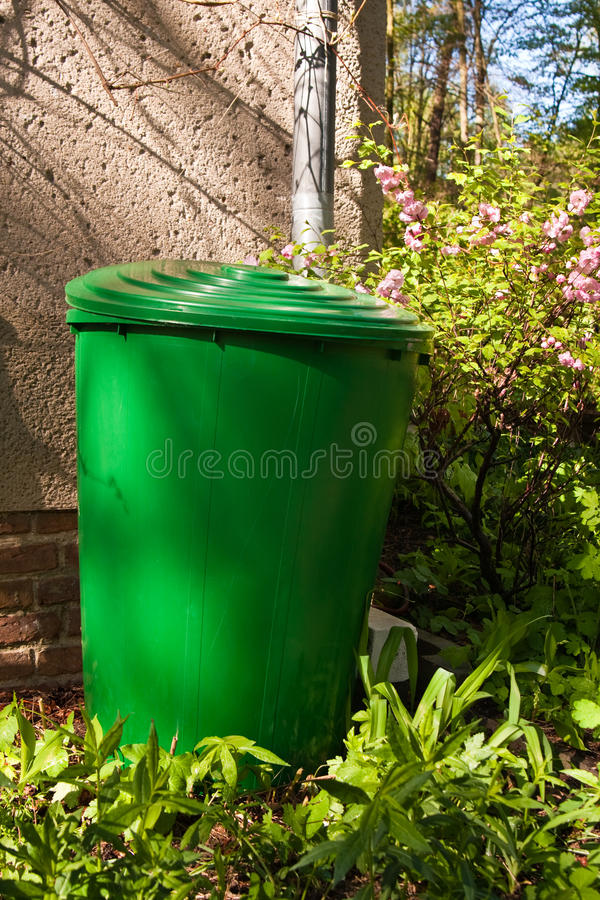 Rain barrel. In a garden in order to collect water stock photos