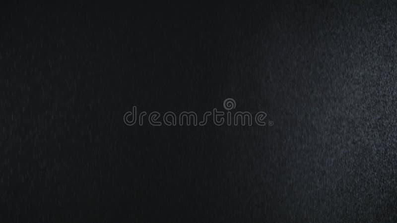 Rain on black background. Slow motiom stock illustration