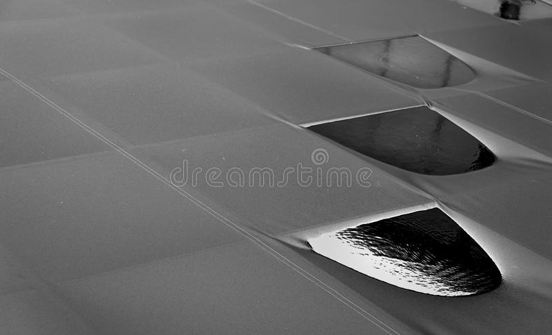 Rain on canvas roof that conveys the loneliness and emptines stock photos