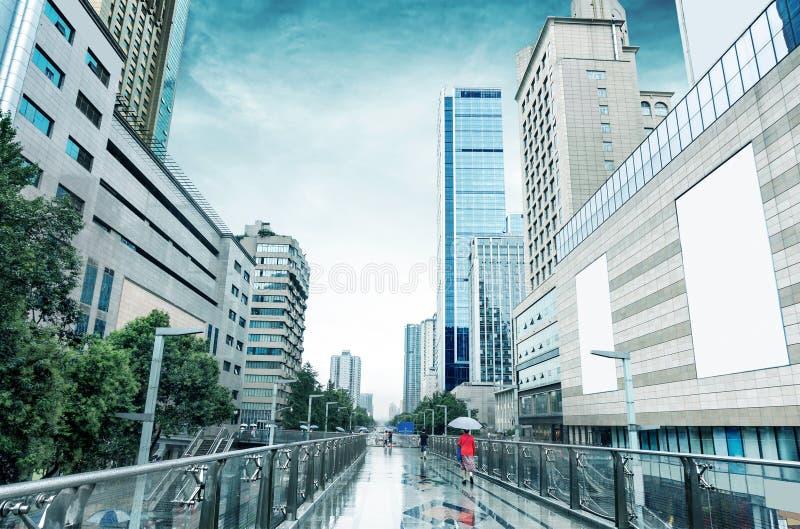 Rain Chengdu, China. Heavy rain in Chengdu, the famous pedestrian shopping street Chunxi Road in Chengdu, China stock images