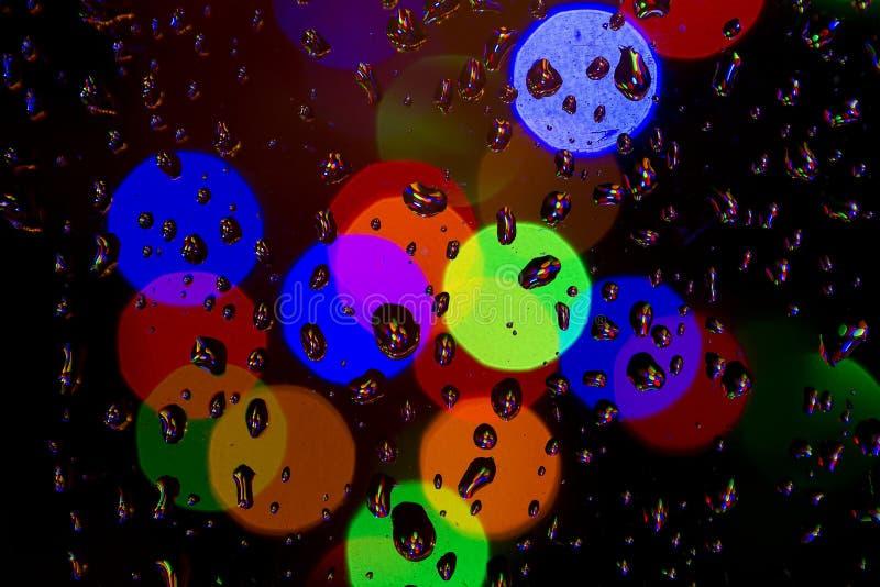 Rain and Christmas lights royalty free stock photography