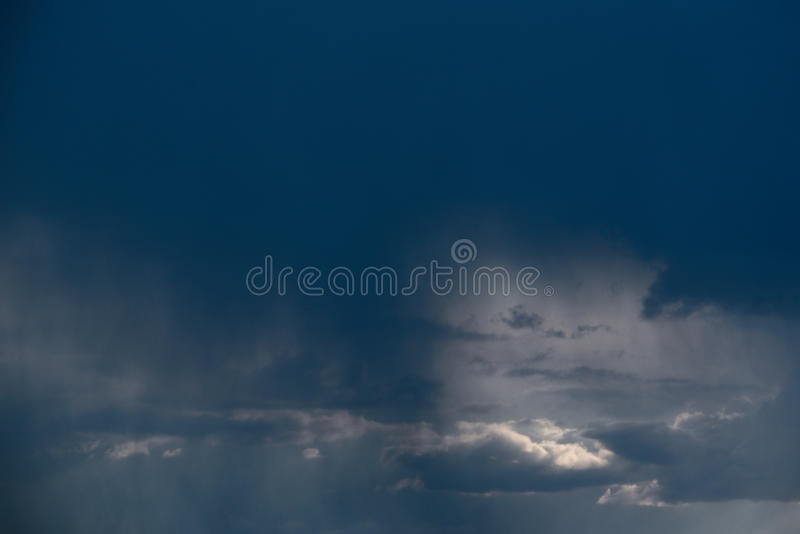 Rain cloud, close-up, rainstorm against the background of the summer sky. Texture. The rain comes from the cloud. The rain comes from the cloud, Dark Sky royalty free stock photography