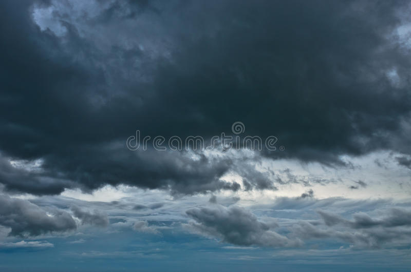 Rain cloud in the sky. Big dark rain cloud in the sky stock photos
