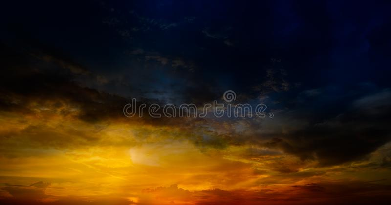 Rain cloud on sky in sunset time. Soft and motion blur rain cloud on blue sky in sunset time for background material royalty free stock images
