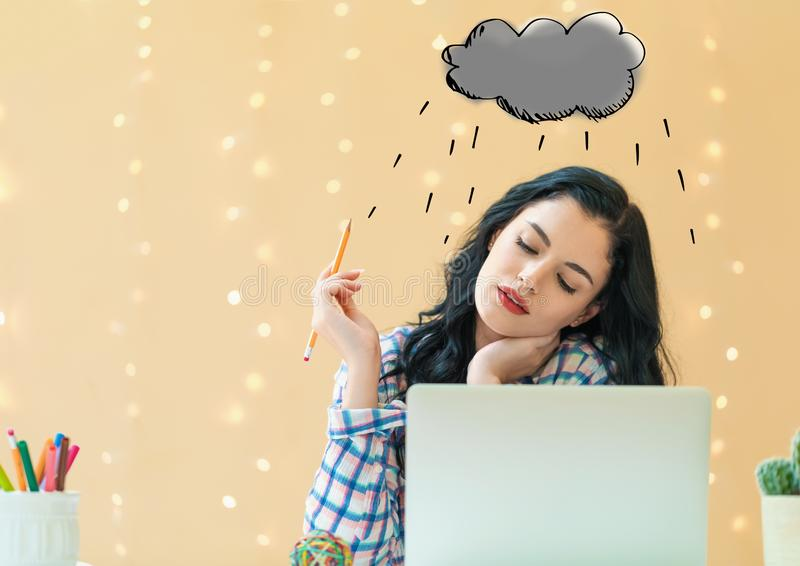 Rain cloud with young woman stock image