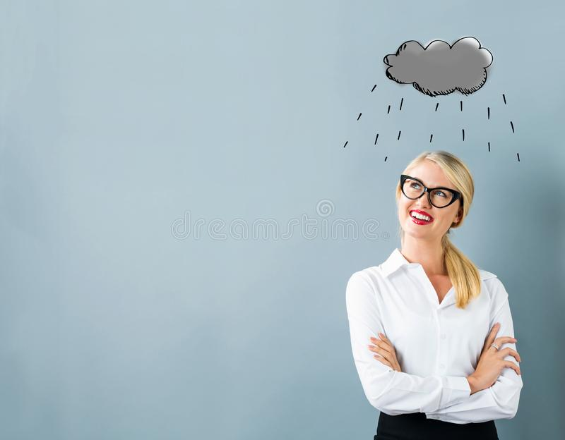Rain cloud with young woman stock photo