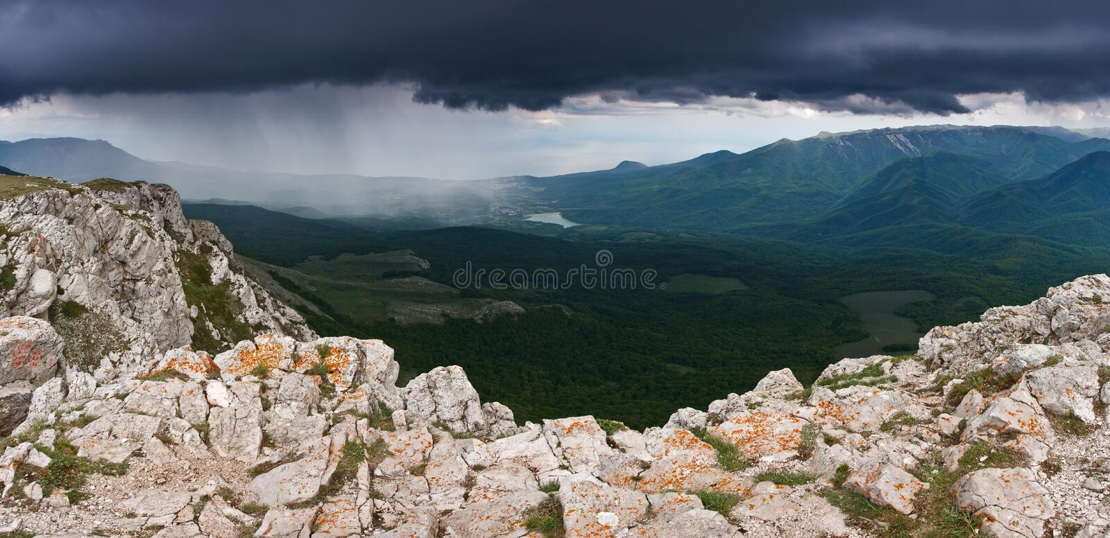 Rain clouds. Landscape with mountains and storm clouds stock images