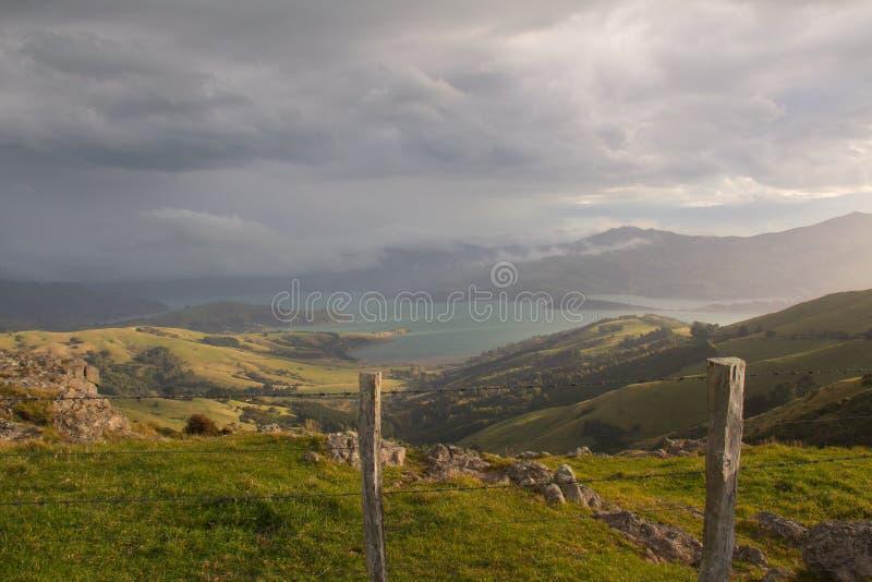 Rain clouds gather over a beautiful lake stock photos