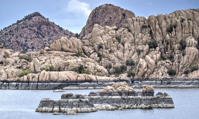 Lake Watson Granite Dells, Prescott Arizona USA. Rain clouds over granite cliffs and boulders of Watson Lake and distant mountains. Lake Watson is one of two stock photos