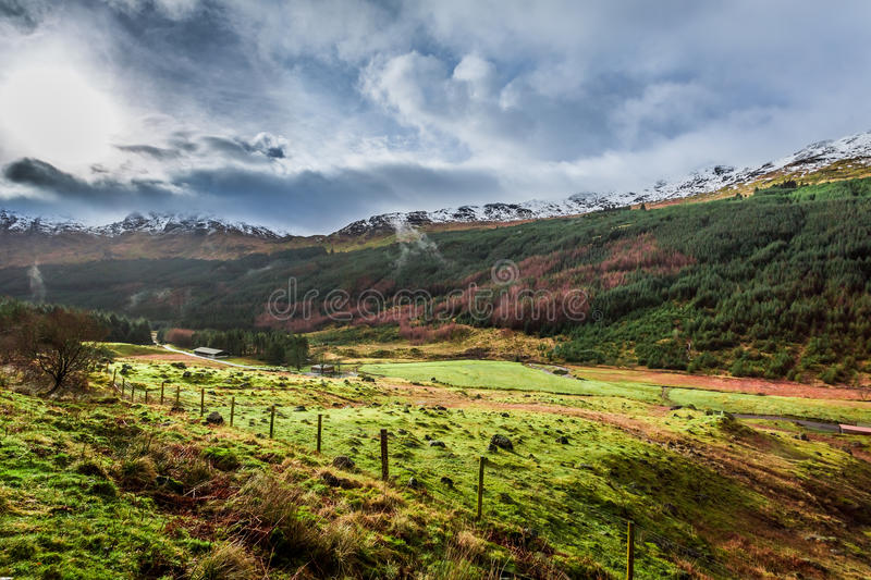 Rain clouds over a mountain valley stock image