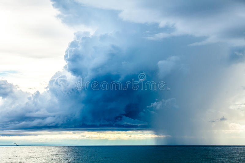 Rain Clouds at the Sea Horizon. In the late afternoon royalty free stock image